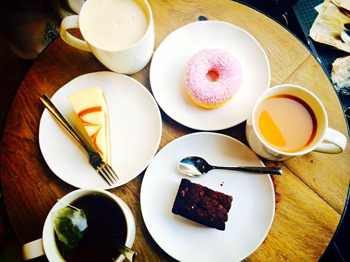 High angle view of desserts and coffee on table
