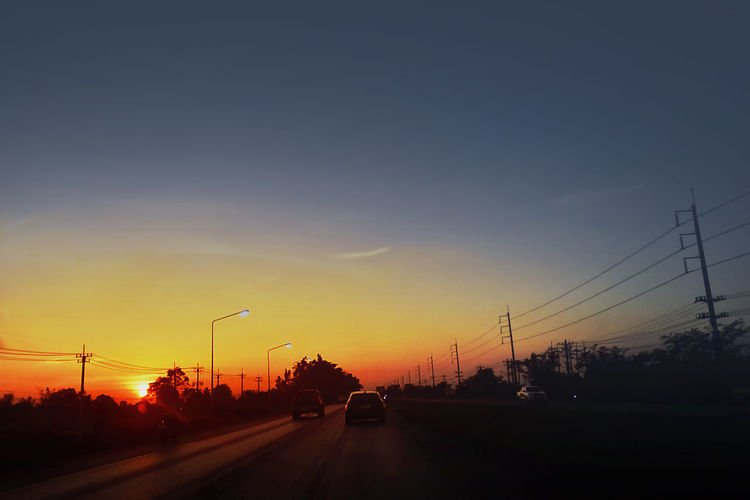 Car driving on road at night,Car transportation Cars High Way Road Cable Car City Day Electricity  Electricity Pylon Land Vehicle Mode Of Transport Nature No People Outdoors Road Silhouette Car Sillouette Sky Street Streetphotography Sunset Telephone Line Transportation Tree Way