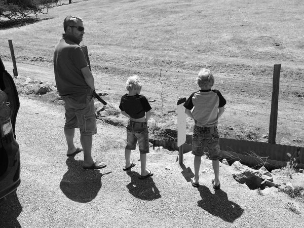Full Length Lifestyles Leisure Activity Casual Clothing Togetherness Rear View Shadow Friendship Vacations Day Outdoors Summer Monochrome Photography Fatherhood Moments Fatherhood  Father And Sons Roadtrip Taking A Leak Break Taking A Break The Drive