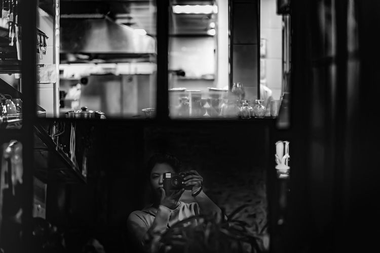 Portrait of man photographing in restaurant