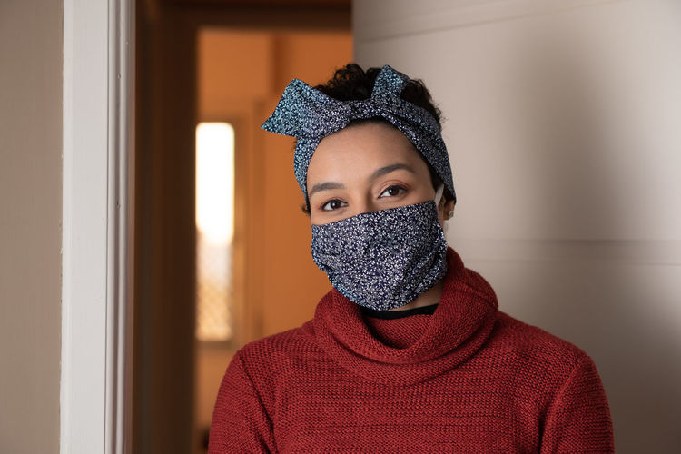 Close up of confident black brazilian woman with protective mask and headband.