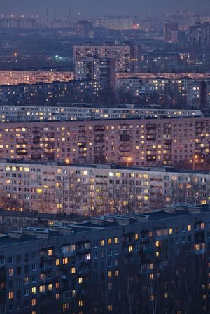 Sleeping quarters at twilight. Lights Soviet Era Twilight Aerial View Architecture Building Exterior Built Structure City Cityscape Illuminated Night No People Outdoors Residential Building Sleeping Quarters Urban Skyline Windows