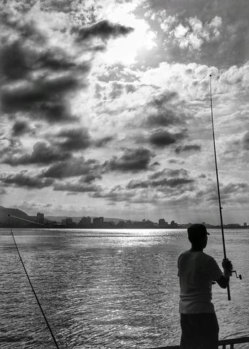 Light And Reflection Fishing Pole Fishing Cloud - Sky Sky Horizon Over Water One Person Water Nature Outdoors Storm Cloud People People Photography The Week Of Eyeem Beauty In Nature Urban Exploration City Life EyeEm Best Shots Street Photography Lights And Shadows Cityspaces Capture The Moment People And Places Black & White Architecture