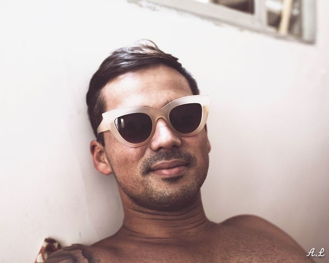 EyeEmNewHere Sunglasses Lifestyles Portrait Indoors  Close-up Natural Light Portrait Domestic Life Streetphotography Streetphoto Men Relaxation Uniqueness portrait Mensfashion Mensportrait Casual Humorous BYOPaper!