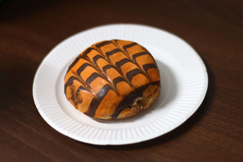 Close-Up Of Donut On Plate