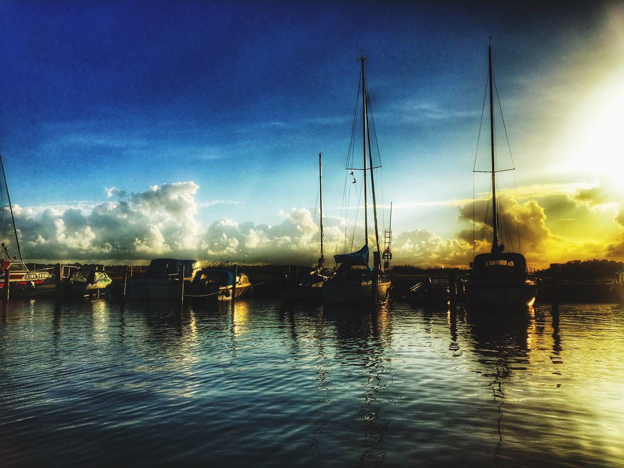 water, sky, no people, tranquility, lake, outdoors, waterfront, reflection, nautical vessel, cloud - sky, tranquil scene, nature, moored, harbor, beauty in nature, sunset, scenics, mast, sailboat, day