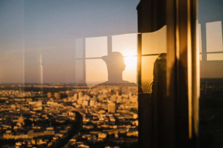 Silhouette of building at sunset
