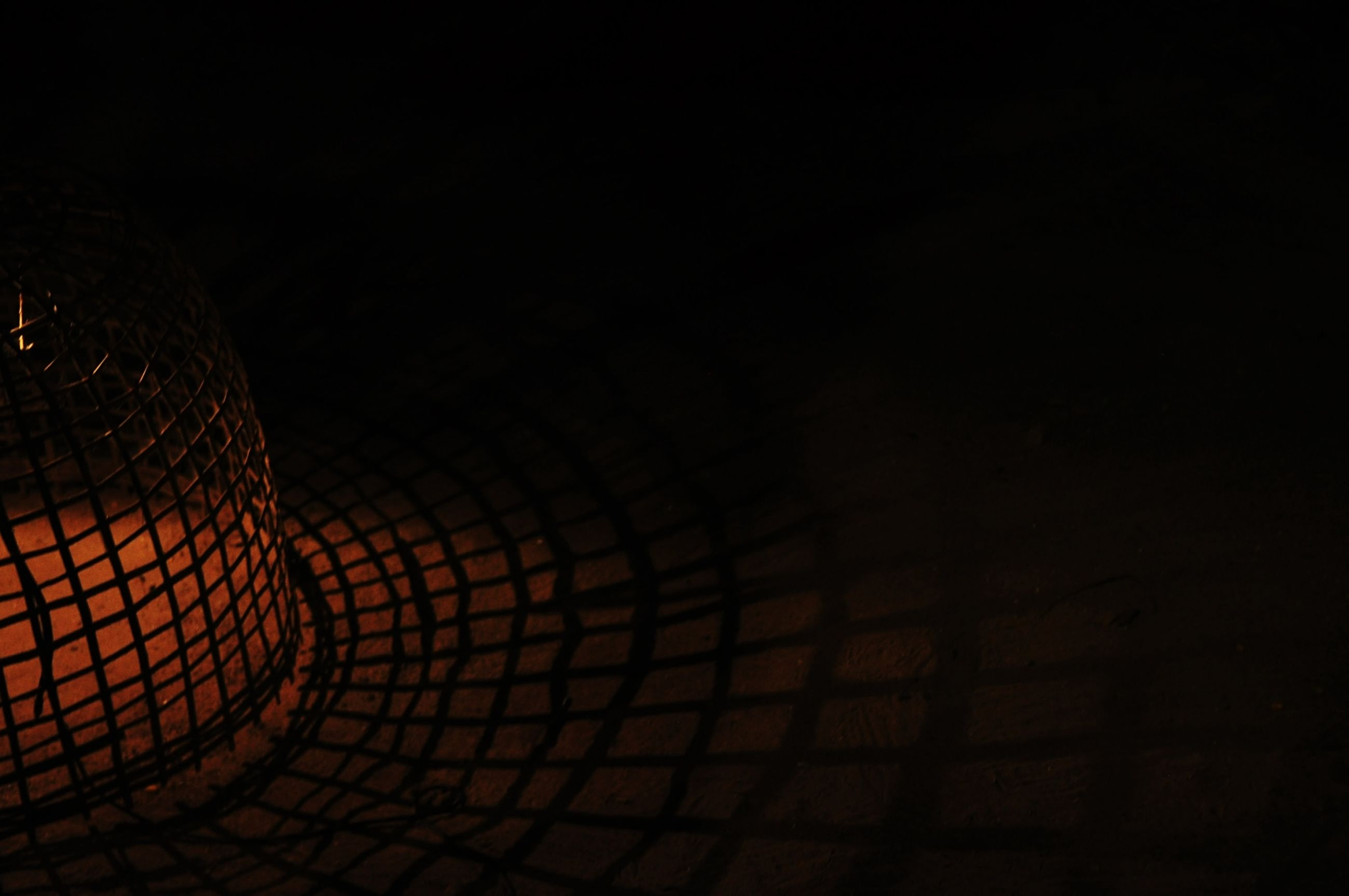 darkness, light, night, reflection, circle, no people, dark, line, copy space, pattern, black, yellow, wire mesh, wire, illuminated, indoors