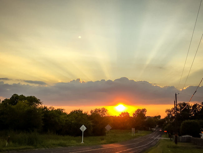 Gorgeous Texas sunset Beauty In Nature Cable Cloud - Sky Day Electricity Pylon Idyllic Landscape Nature No People Orange Color Outdoors Road Scenics Silhouette Sky Sun Sunbeam Sunlight Sunset Telephone Line Tranquil Scene Tranquility Transportation Tree