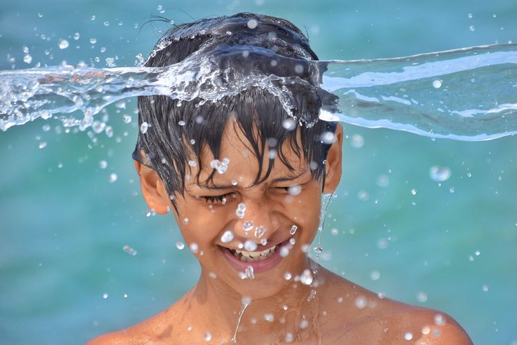 EyeEm Selects Water Wet Headshot Splashing Real People Motion Leisure Activity One Person Lifestyles Childhood Outdoors Day Boys Swimming Shower Nature Close-up People