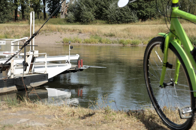 E-bike Weserbergland Beauty In Nature Day Grass Hot Summer Lake Land Mode Of Transportation Moored Nature Nautical Vessel No People Non-urban Scene Outdoors Pedelec Plant Polle Reflection River Weser Summer 2018 Tire Transportation Tree Water Weser Weserfähre Wheel