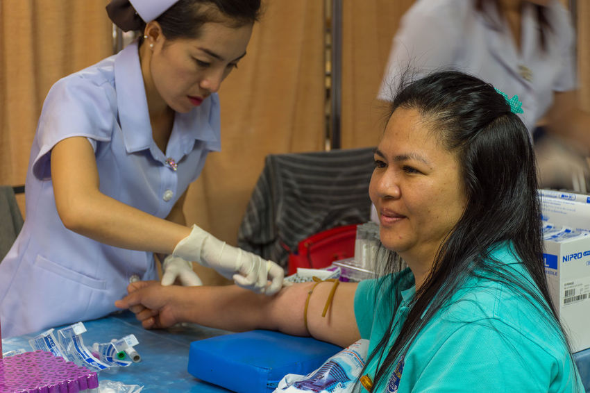 Concentration Doctor  Expertise Healthcare And Medicine Hospital Human Body Part Illness Indoors  Medical Clinic Medical Equipment Medical Exam Medical Occupation Nurse Occupation Patient Protective Glove Real People Scrubs Surgical Glove Syringe Two People Uniform Women Working Young Women