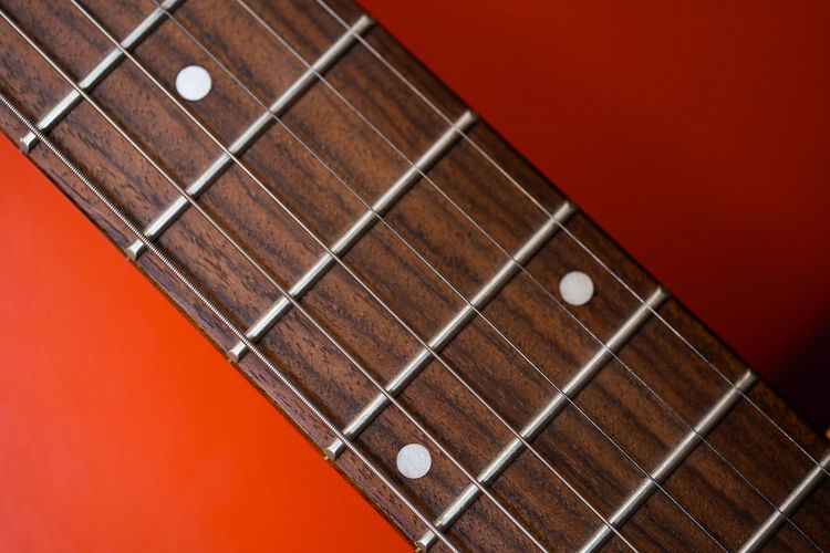 String Instrument Musical Instrument Arts Culture And Entertainment Musical Equipment Musical Instrument String Music String Guitar Fretboard Studio Shot Wood - Material Close-up Colored Background Still Life