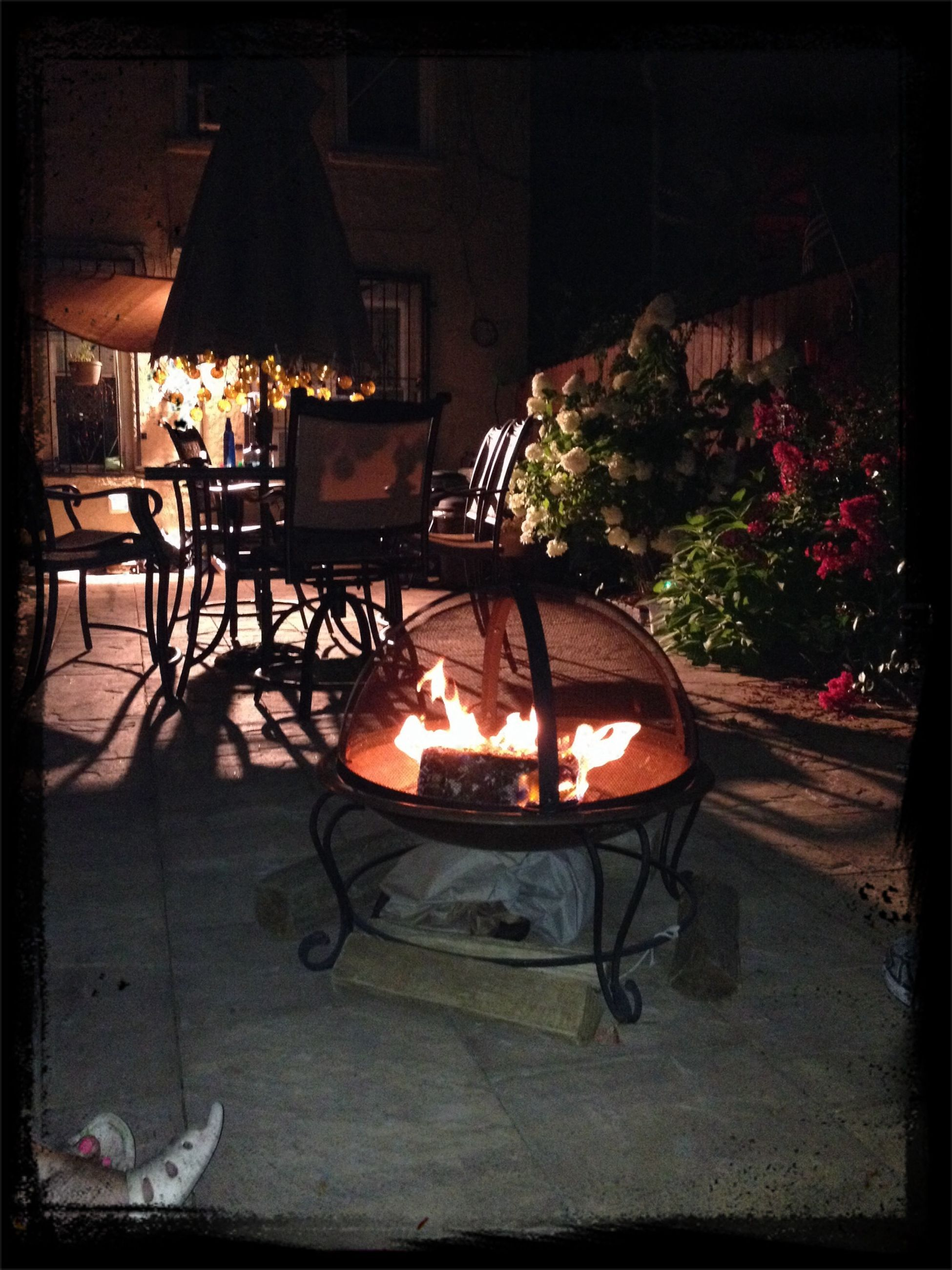 fire - natural phenomenon, illuminated, flame, burning, night, heat - temperature, chair, table, glowing, absence, wood - material, transfer print, house, lighting equipment, no people, fire, auto post production filter, indoors, built structure