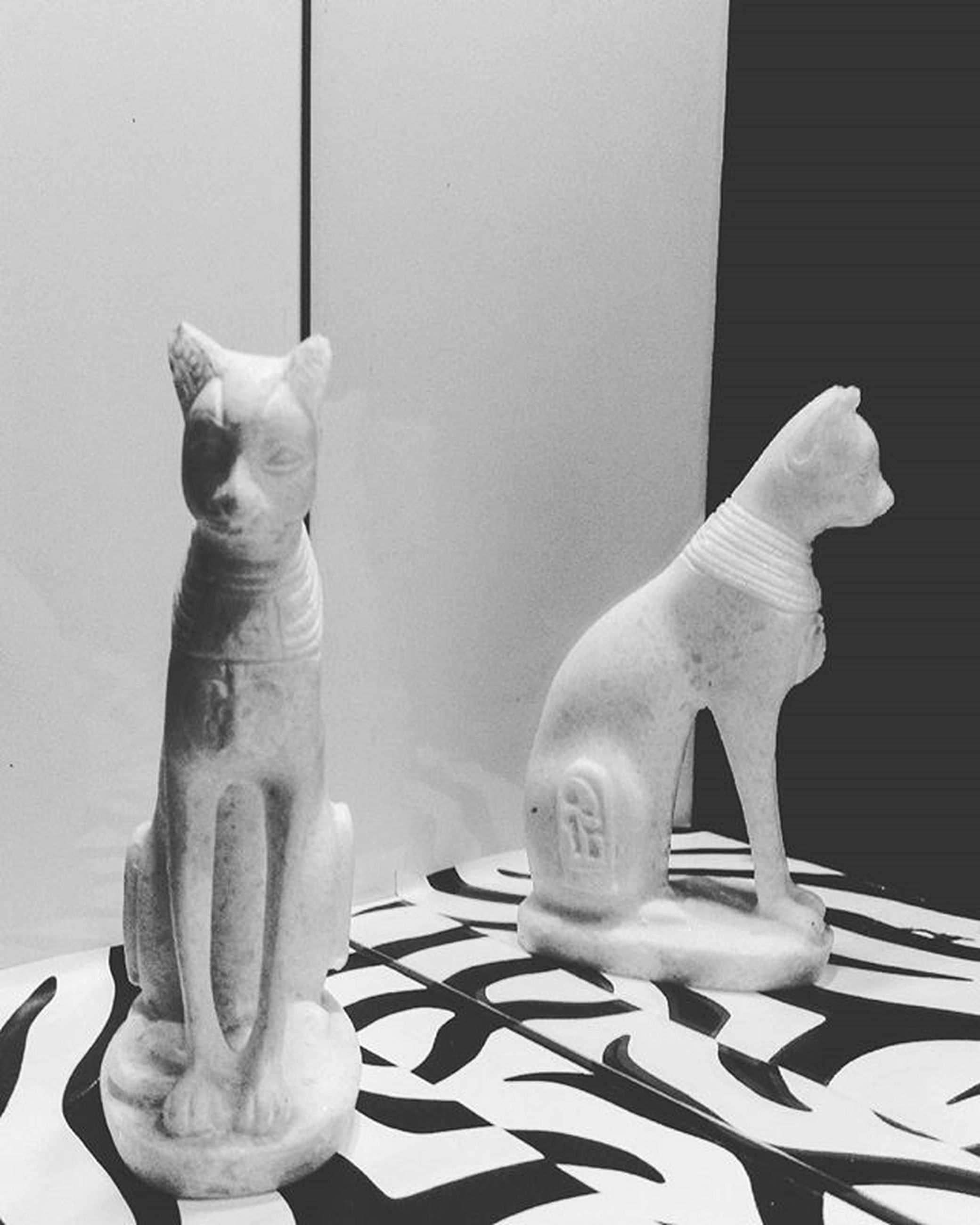 art and craft, sculpture, human representation, statue, art, animal representation, creativity, indoors, craft, built structure, no people, architecture, animal themes, carving - craft product, wall - building feature, day, bird, reflection