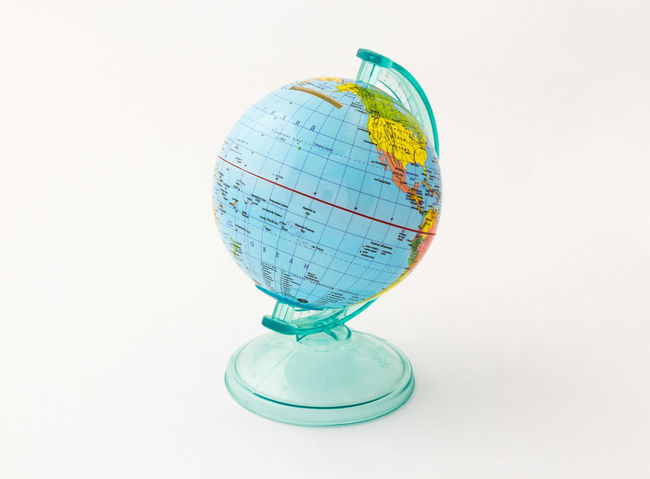 Children's coin box for money made in the form of a globe planet Earth with a slot for money at the top isolated on a white background. Business Currency Earning Earth Isolated Art Bank Banknote Buy Cash Coin Coins Design Exchange Finance Globe Israel Money Pay Planet Shekel Stock Studio Shot Wealth White Background