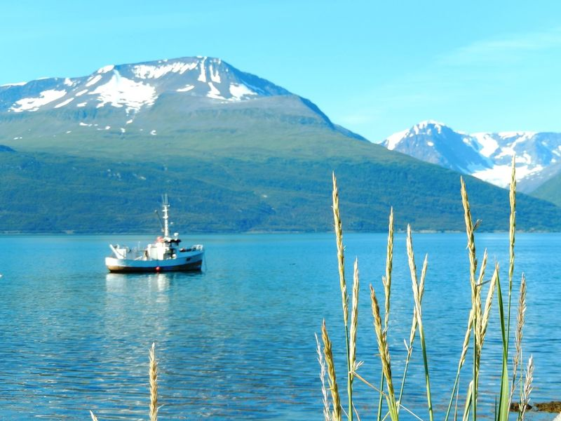 Beauty In Nature Blue Boat Lake Mountain Mountain Range Nature Nautical Vessel Norway Norwegen Scenics Snowcapped Mountain Tranquility Travel Travel Destinations Traveling Water