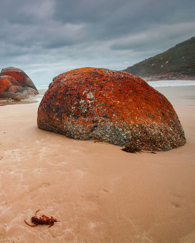 View of rock on beach against sky