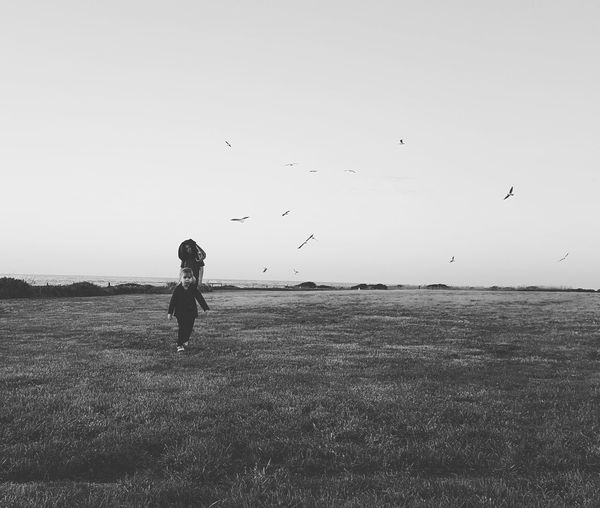 Children Only Flock Of Birds Silhouette Bird Outdoors Beauty In Nature Childhood Sky People Mid-air Child Nature Monochrome Birds Children Walking Dark Moody Black And White EyeEmNewHere TCPM