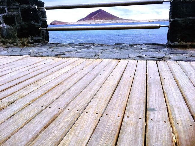 Sea Wood - Material No People Outdoors Nature Day Water Built Structure Mountain Close-up
