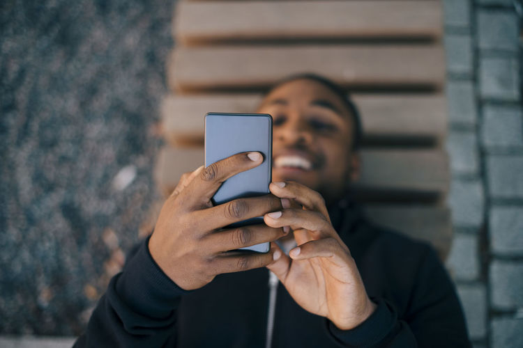 Portrait of man using mobile phone