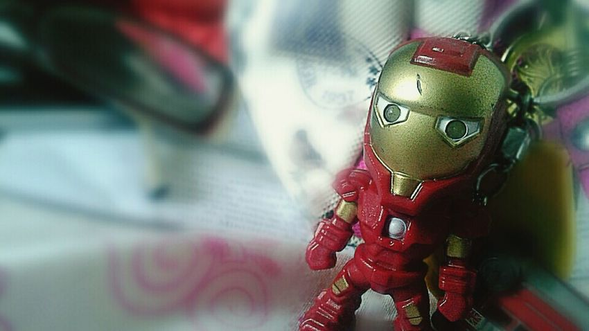 Business Finance And Industry Close-up Arts Culture And Entertainment Day People Outdoors Iron Man Toy Focus