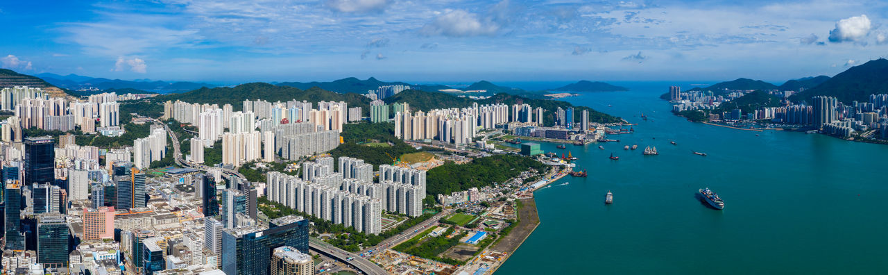Aerial view of cityscape by bay