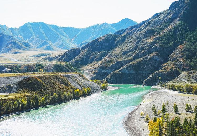 View of the turquoise river katun and the altai mountains, autumn season