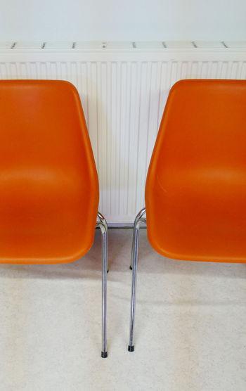 Empty Orange Chairs On Floor