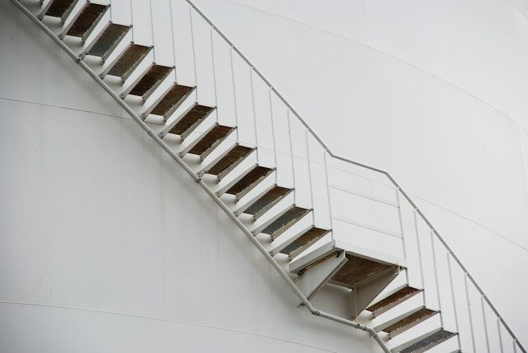 Low Angle View Of Stairs Against The Wall
