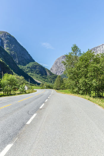 Asphalt Beauty In Nature Canyon Clear Sky Day Dividing Line Landscape Mountain Mountain Range Nature No People Outdoors Road Scenics Sky Stalheim Stalheimsklevia Sunlight The Way Forward Transportation Travel Travel Destinations Tree Winding Road