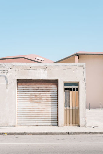 Architecture Art Blue Building Exterior Built Structure Clear Sky Closed Day Door Exterior In Front Of Living No People Outdoors Pastel Colors Residential Structure Shutter Street Window