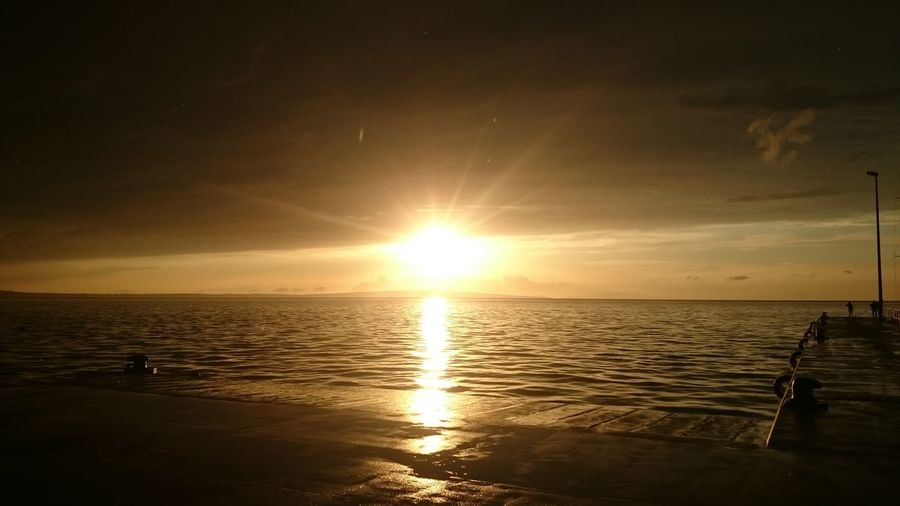 Scenic view of calm sea at sunset