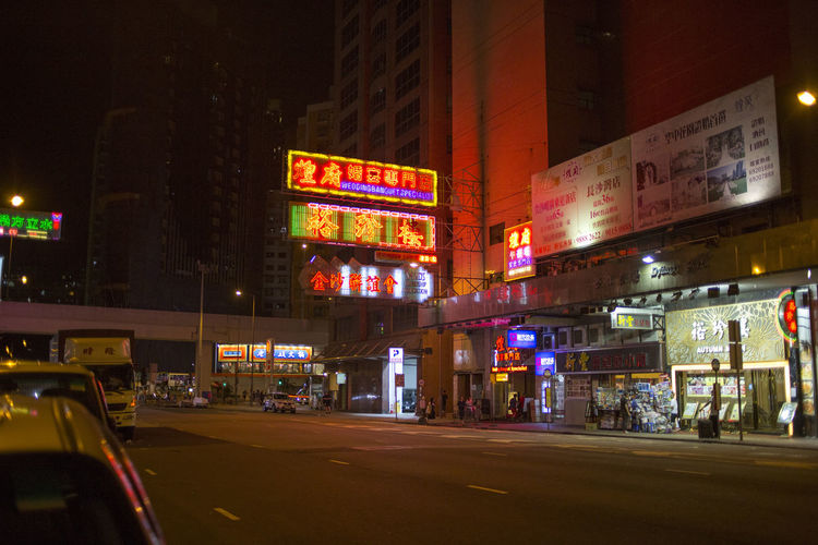 Hong Kong HongKong Advertisement Architecture Building Building Exterior Built Structure Car City City Life City Street Communication Illuminated Land Vehicle Mode Of Transportation Motor Vehicle Night No People Office Building Exterior Road Sign Street Text Transportation