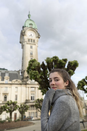 Teenager looking at camera in front of the Limoges station in France 16 Years Architecture City France Limoges Station Travel Travel Photography Traveling Travelling Vacations Architectural Detail Built Structure Monument person Railway Ride Teenage Girls Teenager Tourism Tower Travel Destination Travel Destinations Traveling Photography Urban