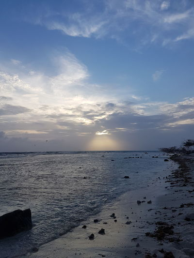 natuur.puur. Aruba Photography No People Noedit Nofilter Samsungphotography Beachphotography Reflection Sleeping Phoneography Water Low Tide Sea Sunset Beach Sand Blue Sun Summer Sky Tide Seascape Coastal Feature Rocky Coastline Standing Water Calm Dramatic Sky Coast