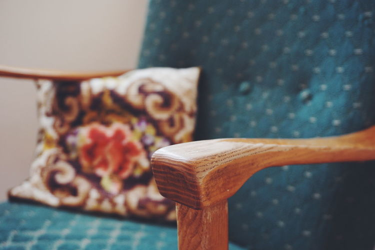 Close-Up Of Retro Style Chair With Cushion At Home