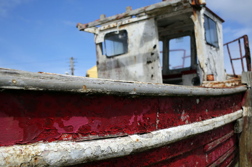 """""""Abandoned Boat"""" Harbour Ireland Wild Atlantic Way Working Boat Abandoned Boat Damaged Day Fishing Boat Low Angle View Metal Nature Nautical Vessel No People Old Outdoors Red Ruined Sky Sunlight Transportation Weathered Window"""