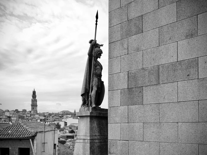 BeW City Cityscape Oporto, Portugal Architecture Art And Craft Black And White Building Building Exterior Built Structure City Cloud - Sky Creativity Day Human Representation Monochrome Nature No People Outdoors Place Of Worship Religion Representation Sculpture Sky Spire  Statue Travel Destinations