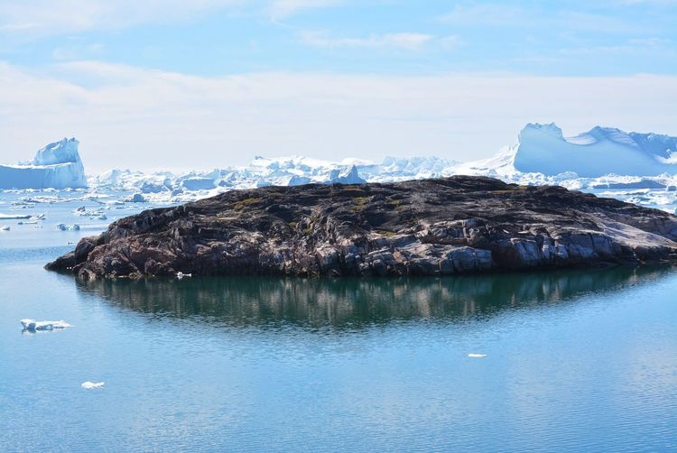 Ilulissat, Greenland, July | UNESCO world heritage site | impressions of Jakobshavn | Disko Bay Kangia Icefjord | huge icebergs in the blue sea on a sunny day | climate change - global warming Beauty In Nature Nature Outdoors Icebergs Iceberg Greenland Climate Change Global Warming UNESCO World Heritage Site Arctic Melting Glacier Natural Beauty Cold Temperature Day Summer Tranquility Nordic Scenery Scenics - Nature Tranquil Scene No People Waterfront Hikingadventures Outdoor Photography Travel Destinations