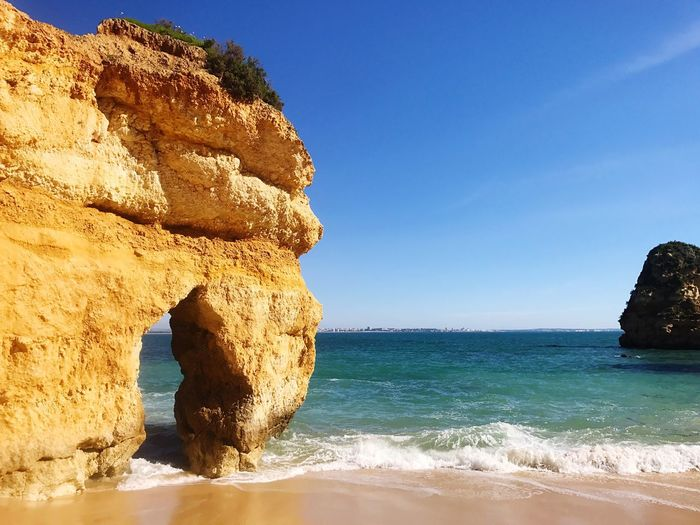 Lagos Algarve Portugal Dona Ana Beach Nature Sea Beauty In Nature Scenics Water Sunlight Rock Formation Blue Rock - Object Day Tranquil Scene Clear Sky Tranquility No People Geology Horizon Over Water Outdoors Sky Beach