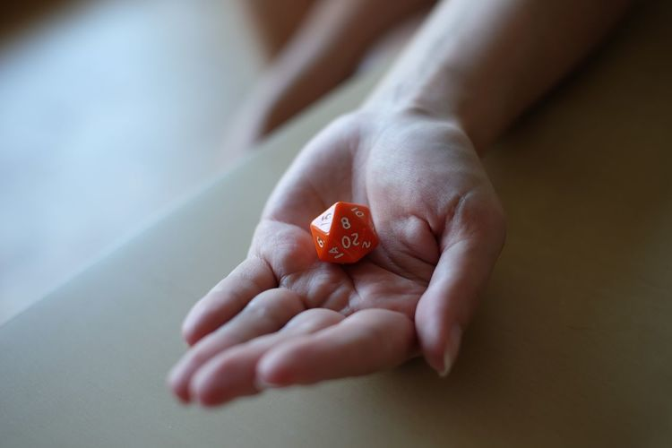 Cropped Image Of Person Holding Dice At Home