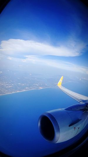 Airplane Transportation Flying Mode Of Transport Sky Travel Aircraft Wing Aerial View Air Vehicle Journey Mid-air Airplane Wing Nature Cloud - Sky Scenics Beauty In Nature No People Day Landscape Outdoors Beach Above The Ocean Bird Eyes View EyeEmNewHere
