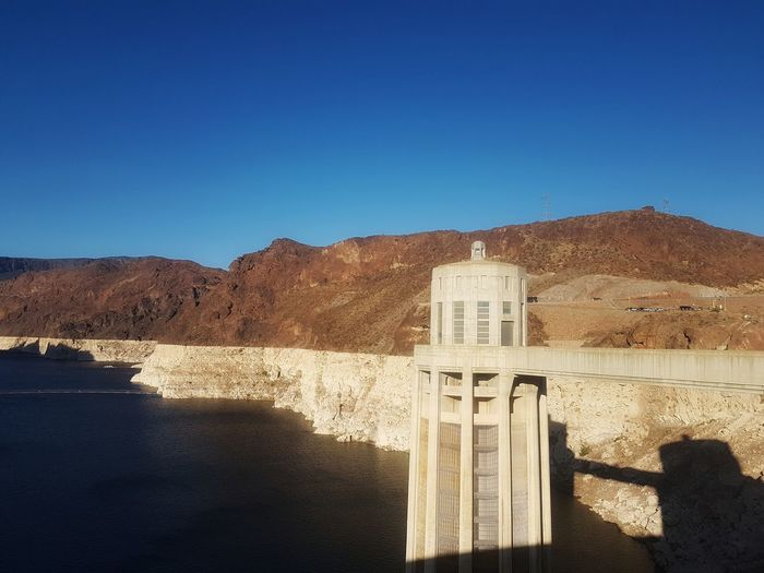 Hoover Dam Love PhonePhotography Samsungphotography Eyeemphotography EyeEmSelect Outdoor Photography Nature Dam Water Manmade Manmadestructures Wonderful USA Desert Shadow Sand Clear Sky Mountain Beach Sunlight Sky Architecture Built Structure Calm Hydroelectric Power Stream Horizon Over Water Reservoir
