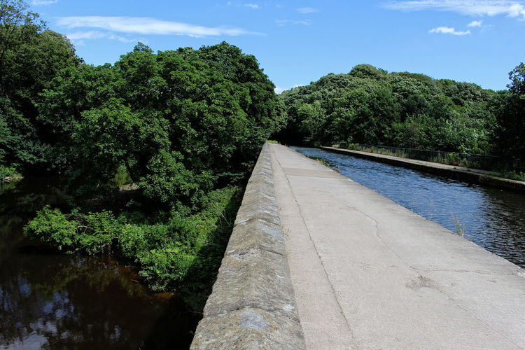 Over the river. Aqueduct Canal And Waterway Beauty In Nature Blue Built Structure Canal Path Cloud - Sky Day Direction Engineering Green Color Growth Nature No People Outdoors Plant River Scenics - Nature Sky Tranquil Scene Tranquility Transportation Tree Water