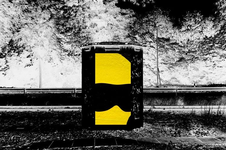 Railway Yellow No People Outdoors Transportation Nature Sign Day Close-up Architecture Road Built Structure Street Black Color Communication Guidance Wall - Building Feature