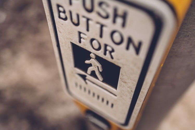 Close-up Communication Day High Angle View No People Outdoors Push Button Text Traffic Lights Walk Button