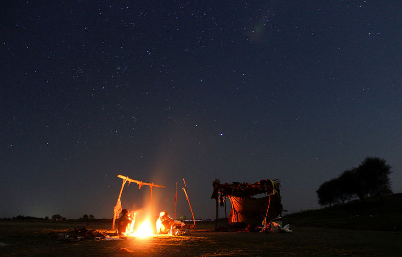 HAppy Family under the stars Be. Ready. Nightphotography Astronomy Beauty In Nature Bonfire Campfire Clear Sky Fire Flame Human Hut Long Exposure Men Nature Night Nightlife Outdoors People Real People Scenics Sky Slow Shutter Star - Space Togetherness Tree