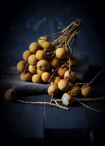 Longan. An exotic Asian fruit. 🖤 Longan Black Background High Angle View Freshness Food Healthy Eating Table Indoors  No People Studio Shot Jute Wood - Material Still Life Food And Drink Langsat Fruits Fruit Dark Food Photography Moody Photography Food Stories