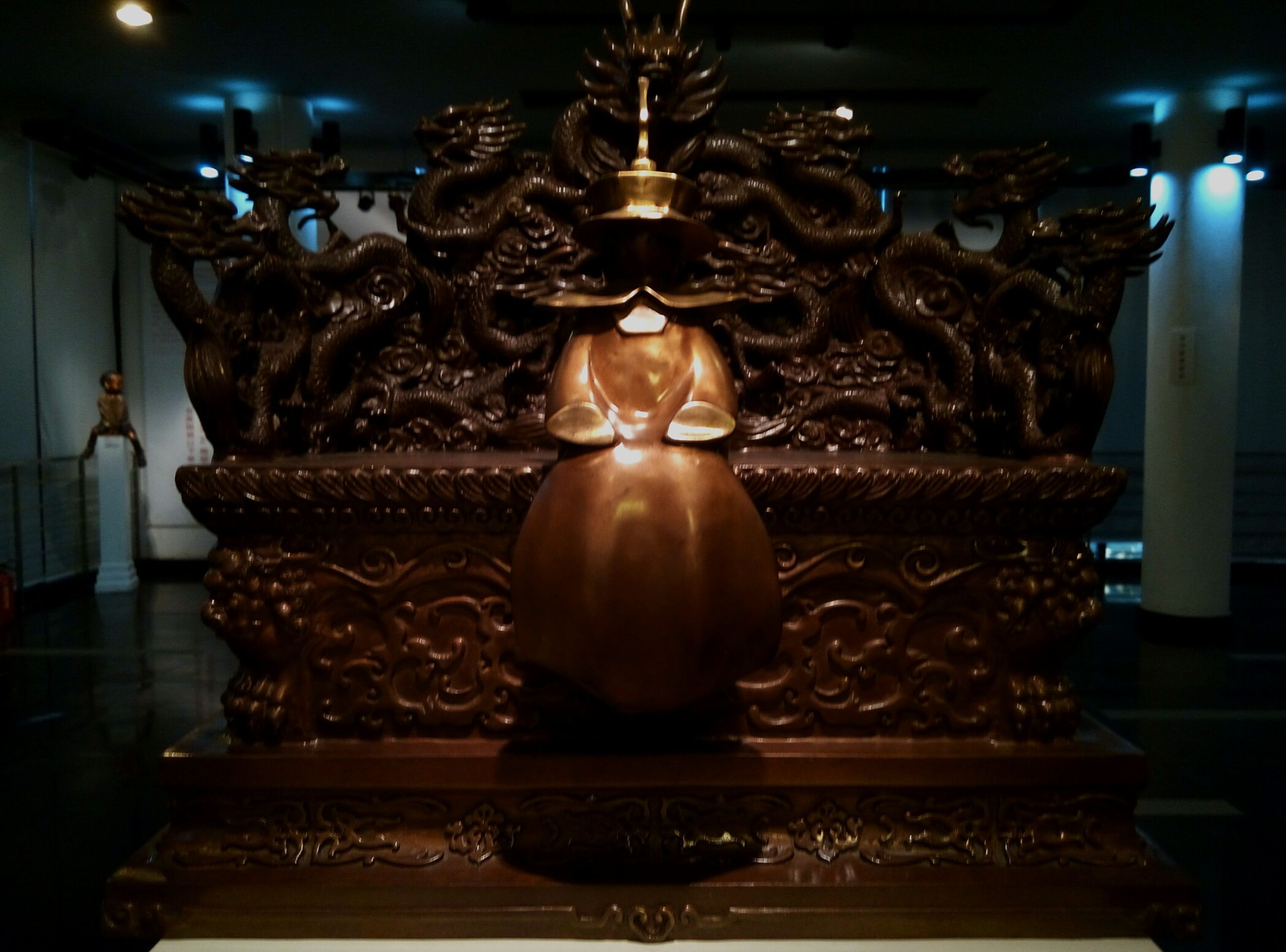 indoors, art and craft, art, religion, statue, sculpture, place of worship, creativity, human representation, spirituality, illuminated, ornate, buddha, temple - building, decoration, gold colored, night, design